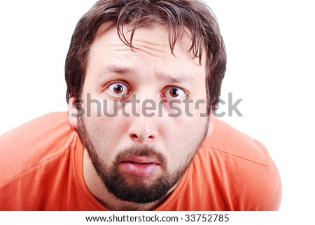 Man with surprised expression on face - stock photo