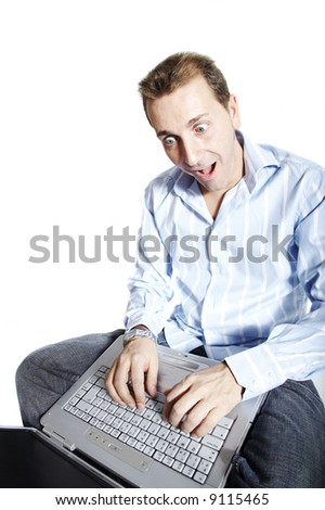 Man with surprised face using a laptop computer. Isolation on white. - stock photo