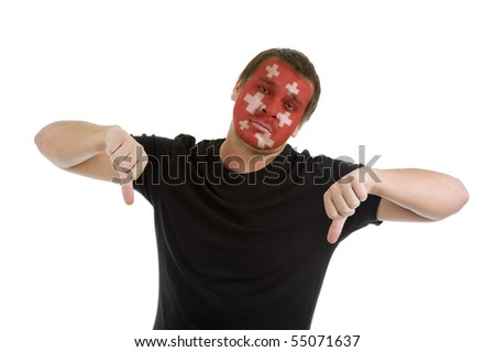 man with swiss flag painted on his face showing two thumbs down, isolated on white background - stock photo