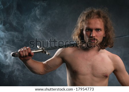 Man with sword in smoke - stock photo