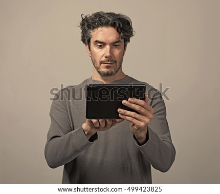 Man with tablet computer.