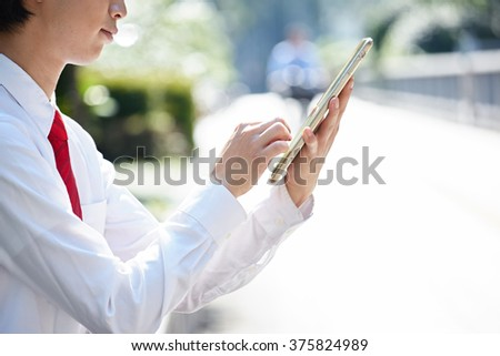 Man with tablet pc on hand - stock photo