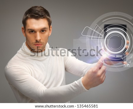 man with tablet pc touching virtual screen - stock photo