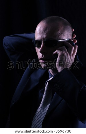 Man with telephone, dressed in black