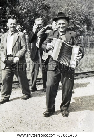 man with the accordion - photo scan, about 1950 - stock photo