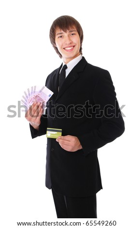 man with the credit card and money is smiling. isolated at white background - stock photo