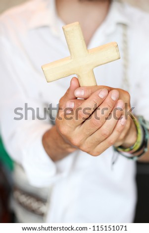 Man with the cross in hands