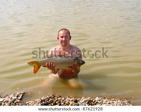 Man with the fish he has just caught - stock photo