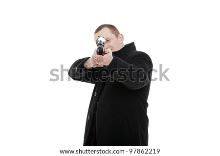 Man with the gun facing - stock photo