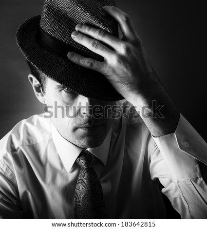 Man with the hat in black and white photo, artistic man photo, man portrait close up, man fashion photo, man isolated in dark background, concept, artistic photo, model male, man in 35 years, serious  - stock photo