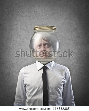 Man with the head in a glass container - stock photo
