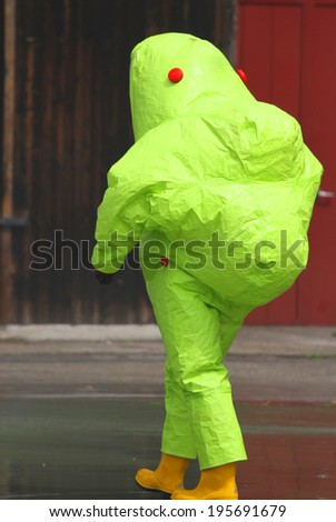 man with the yellow suit and breathing apparatus to enter contaminated sites in complete safety - stock photo