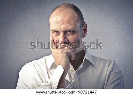 Man with thoughtful expression - stock photo