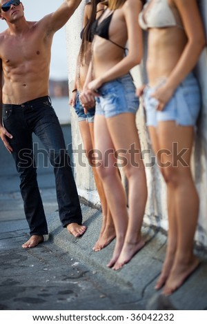 Man with three young beautiful  women in line