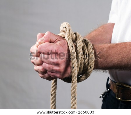 Man with tied hands - stock photo