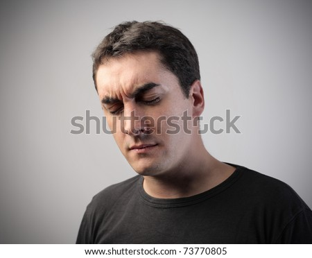 Man with tired expression - stock photo