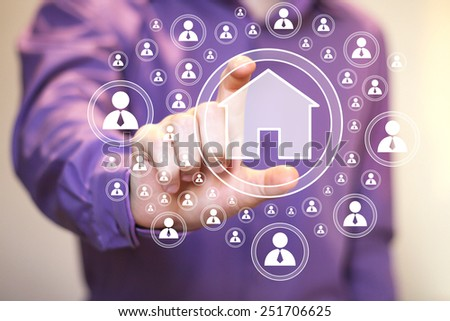 Man with touchscreen house network web - stock photo