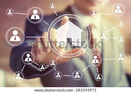 Man with touchscreen house web icon - stock photo