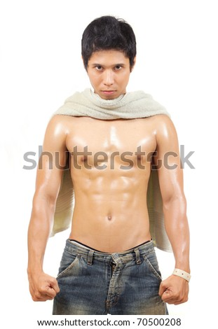 man with towel showing his body - stock photo