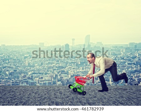 man with toy trolley and urban background