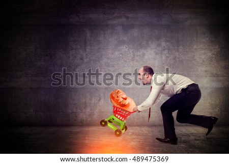 man with trolley and halloween pumpkin