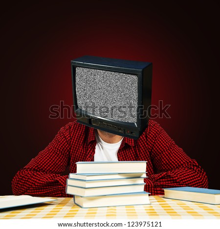 Man with TV head reading books. Brainwashed TV generation concept. - stock photo
