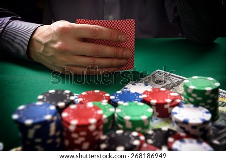 man with two cards playing in poker, close up