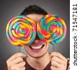 Man with two lollipop eyes - stock photo
