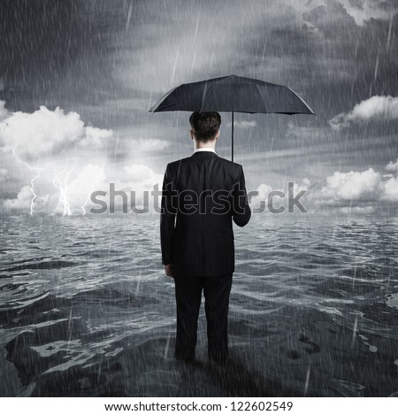 man with umbrella business concept - stock photo