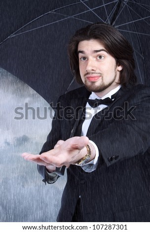 Man with Umbrella Checking for Rain (clearing or coming) Optimistic