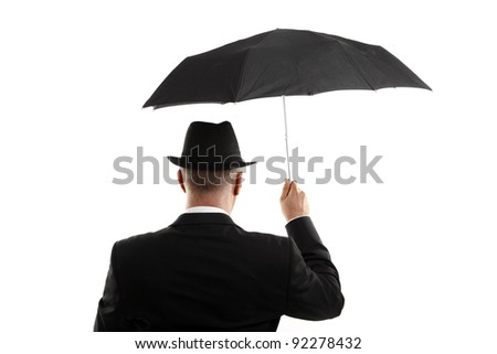 Man with umbrella view from back - stock photo
