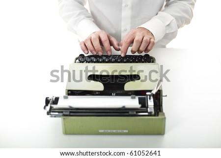 man with vintage typewriter selective focus image - stock photo