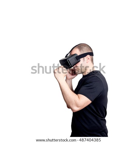 Man with virtual reality headset playing a sport fight video game isolated on white background. Entertainment and gaming technology concept.
