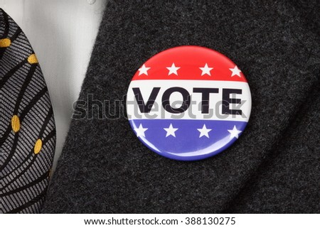 man with Vote button  pinned on his  suit - stock photo