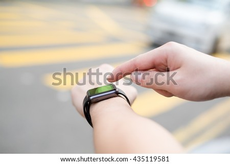 Man with wearable smart watch