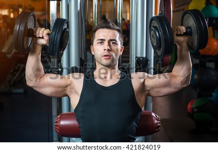 man with weight training equipment on sport gym club. - stock photo