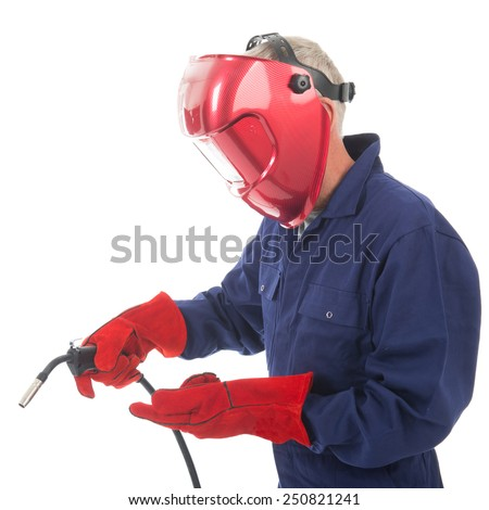 man with welding mask and red protective gloves isolated over white background