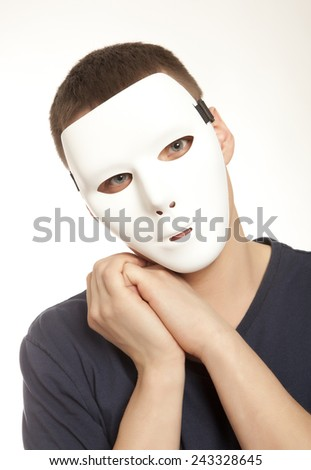 Man with white carnival mask - stock photo