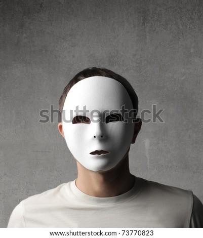 Man with white carnival mask