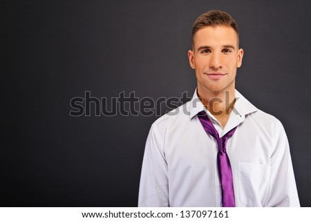 Man with white shirt over dark background - stock photo
