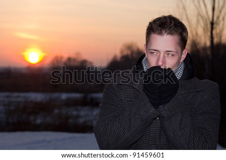 man with winter sun standing on snow