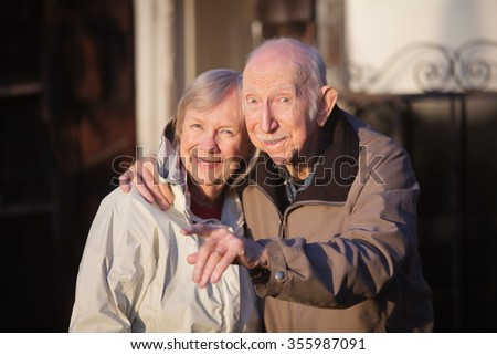Man with woman outdoors pointing his finger - stock photo