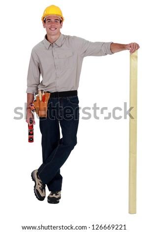 Man with wood plane - stock photo