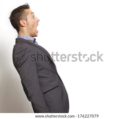 Man with wow face.Space for copy.Isolated on white - stock photo