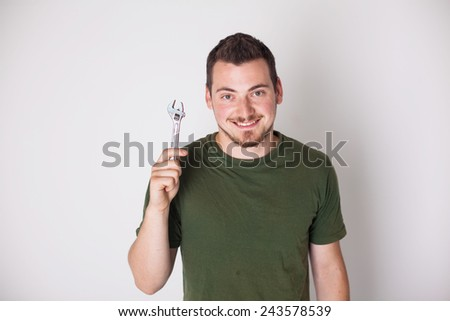 man with wrench on a white background - stock photo