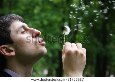 man with yellow dandelions