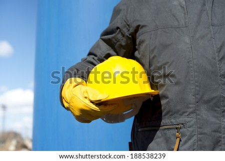 man with yellow hardhat and gloves - stock photo