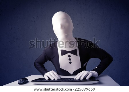 Man without identity working with keyboard and mouse on blue background - stock photo