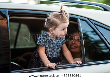 Man woman and child near the car are going on a trip - stock photo