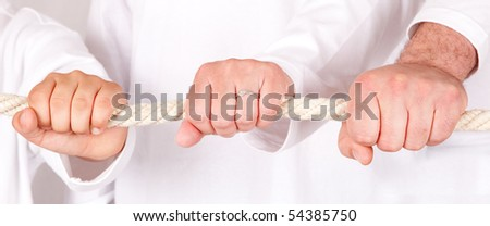 Man,woman and child pulling in one direction. Isolated on a white background. - stock photo